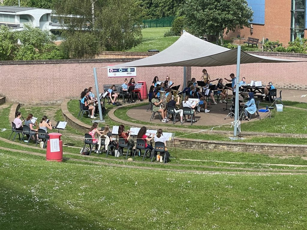 PHOTO: Students rehearse in the summer sunshine